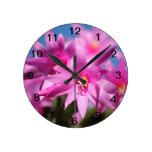 De las flores rosa tan reloj de pared