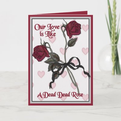 Two dead red roses. An anti valentine's day card or gothic design for