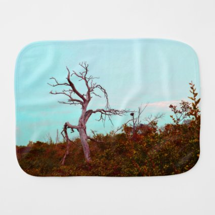 dead tree against green leaves sky teal baby burp cloth