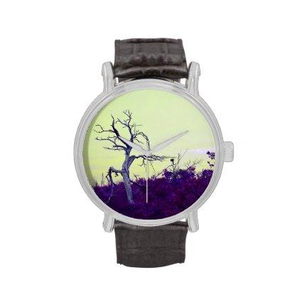 dead tree purple yellow leaves sky wristwatch