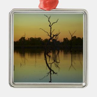 Dead trees reflected in Lily Creek Lagoon, dawn Square Metal Christmas Ornament
