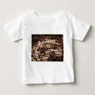 Dead wood and leaves on the forest floor. baby T-Shirt