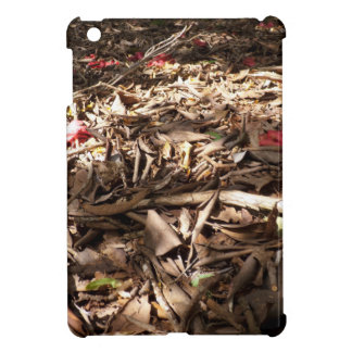 Dead wood and leaves on the forest floor iPad mini cases