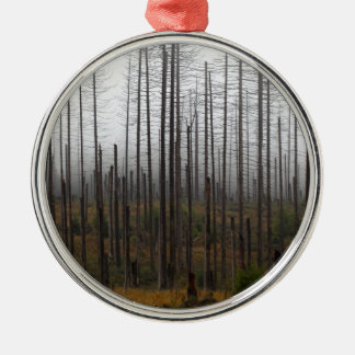 Death spruce trees metal ornament