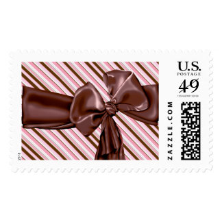 Decadent chocolate bow with stripey background postage