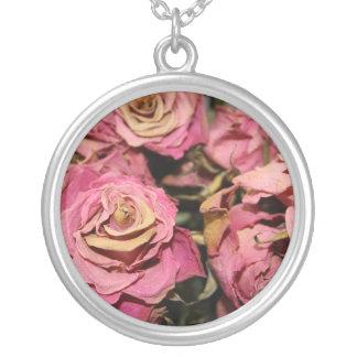Decaying roses round pendant necklace