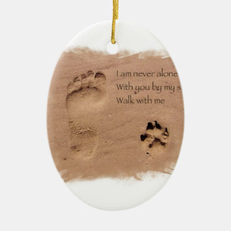 Deceased dog in loving memory footprints in sand Double-Sided oval ceramic christmas ornament