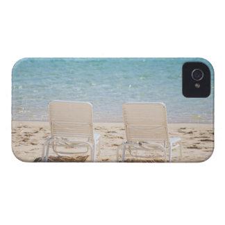 Deck chairs on sandy beach iPhone 4 case