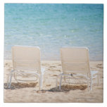 Deck chairs on sandy beach large square tile