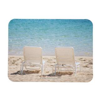 Deck chairs on sandy beach magnet