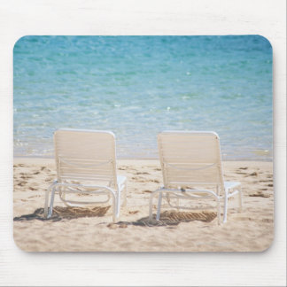 Deck chairs on sandy beach mouse pad