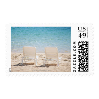 Deck chairs on sandy beach stamps
