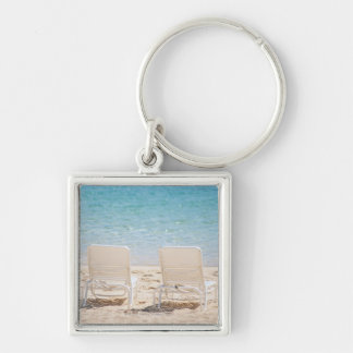 Deck chairs on sandy beach Silver-Colored square keychain