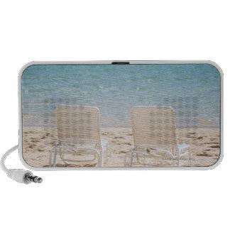 Deck chairs on sandy beach laptop speakers
