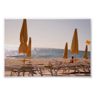 Deckchairs and the beach poster