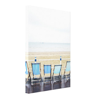 Deckchairs on a Wet and Deserted Promenade Canvas Print