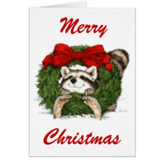 Decoración y mapache de la guirnalda del navidad tarjetón