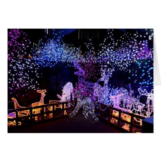 Decoraciones rosadas y púrpuras del navidad al tarjeta de felicitación