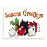 Decoraciones y gatito negro (los saludos de la est postal
