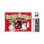 Decoraciones y gato negro (los saludos de la sello