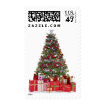 Decorated christmas tree and presents postage stamp