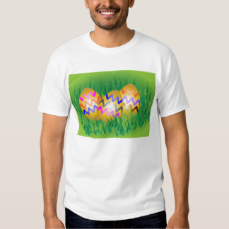 Decorated gold Easter eggs on grass T-shirt