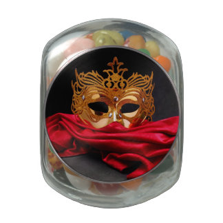 Decorated mask for masquerade on red velvet jelly belly candy jars