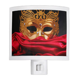 Decorated mask for masquerade on red velvet night light