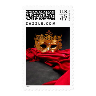 Decorated mask for masquerade on red velvet postage