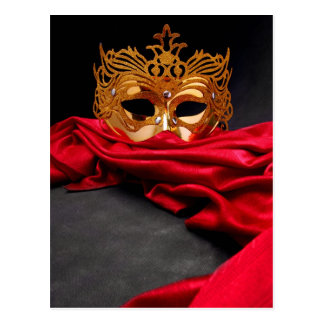 Decorated mask for masquerade on red velvet postcard