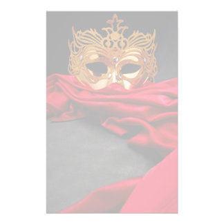 Decorated mask for masquerade on red velvet stationery