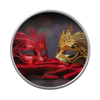 Decorated masquerade mask on red velvet candy tin
