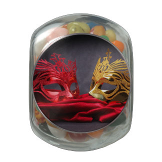 Decorated masquerade mask on red velvet glass jars