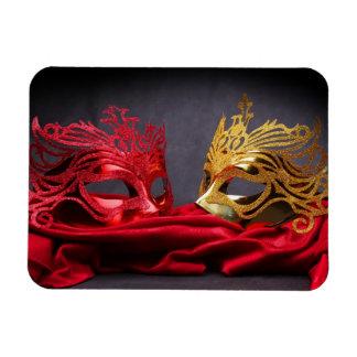 Decorated masquerade mask on red velvet magnet