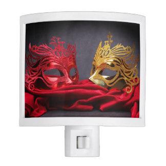 Decorated masquerade mask on red velvet night light