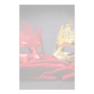Decorated masquerade mask on red velvet stationery