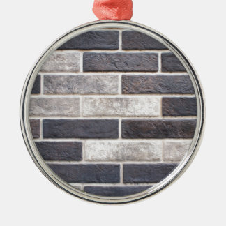 Decorative brickwork of white and black bricks metal ornament