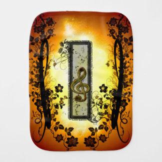 Decorative clef on a frame burp cloth