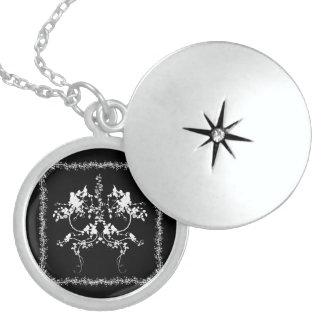 Decorative flower design round locket necklace