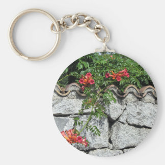 Decorative stone wall with colorful flowers key chain