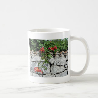 Decorative stone wall with colorful flowers classic white coffee mug