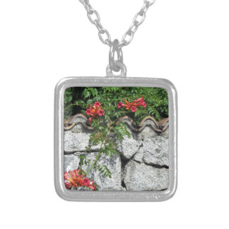 Decorative stone wall with colorful flowers silver plated necklace