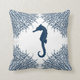 Decorative throw pillow with seahorse and coral