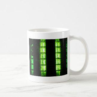 Decorative wall with green glowing at night coffee mug