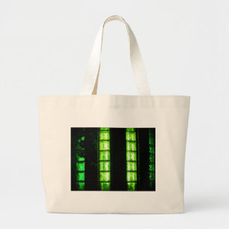 Decorative wall with green glowing at night jumbo tote bag