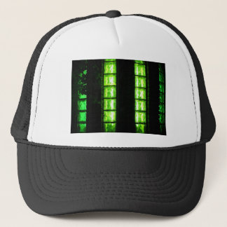 Decorative wall with green glowing at night trucker hat