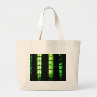 Decorative wall with green lights at night large tote bag