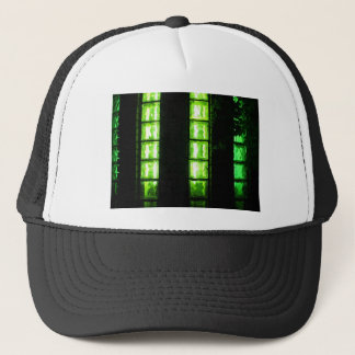 Decorative wall with green lights at night trucker hat
