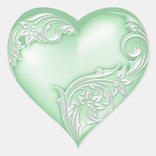 Decorativo blanco de la menta w de la voluta del pegatina en forma de corazón
