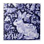 """Dedham Blue Rabbit, Classic Blue & White Design Tile<br><div class=""""desc"""">My original blue and white rabbit design was originally featured on a glazed ceramic tile. With birds,  vines and flowers adapted from ancient oriental pottery motifs,  this design will appeal to rabbit lovers,  and collectors of blue and white pottery.</div>"""